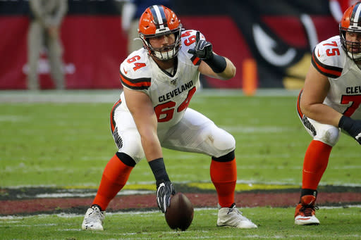 FILE - In this Dec. 15, 2019, file photo, Cleveland Browns center JC Tretter (64) lines up against the Arizona Cardinals during the first half of an NFL football game in Glendale, Ariz. The Browns center and NFLPA president says he will push for daily testing for the coronavirus as the NFL ramps up to a possible season. (AP Photo/Rick Scuteri, File)