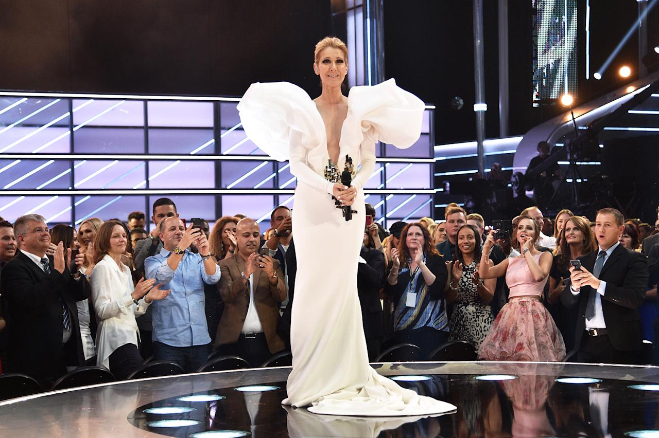 """<p>Who'd have thought that the songstress would reinvent herself <span>— </span>and reinvigorate her already amazing career <span>— </span>by becoming <a rel=""""nofollow"""" href=""""https://www.yahoo.com/lifestyle/c-line-dion-became-fashion-205806151.html"""">a style icon</a> at 49? After losing her husband to cancer in early 2016, Dion was seemingly determined to make 2017 a better year, and she did, starting with her first appearance at the iconic Met Ball, and later gallivanting all over Paris Fashion Week in the summer, which had everyone stalking her on Instagram to see <a rel=""""nofollow"""" href=""""https://www.yahoo.com/entertainment/celine-dions-getting-groove-back-203235823.html"""">what she would wear next</a>. And don't forget her awesome habit of spontaneously <a rel=""""nofollow"""" href=""""https://www.yahoo.com/entertainment/celine-dion-loves-spontaneously-breaking-song-204356429.html"""">breaking out into song</a>! (Photo: Kevin Mazur/Getty Images) </p>"""