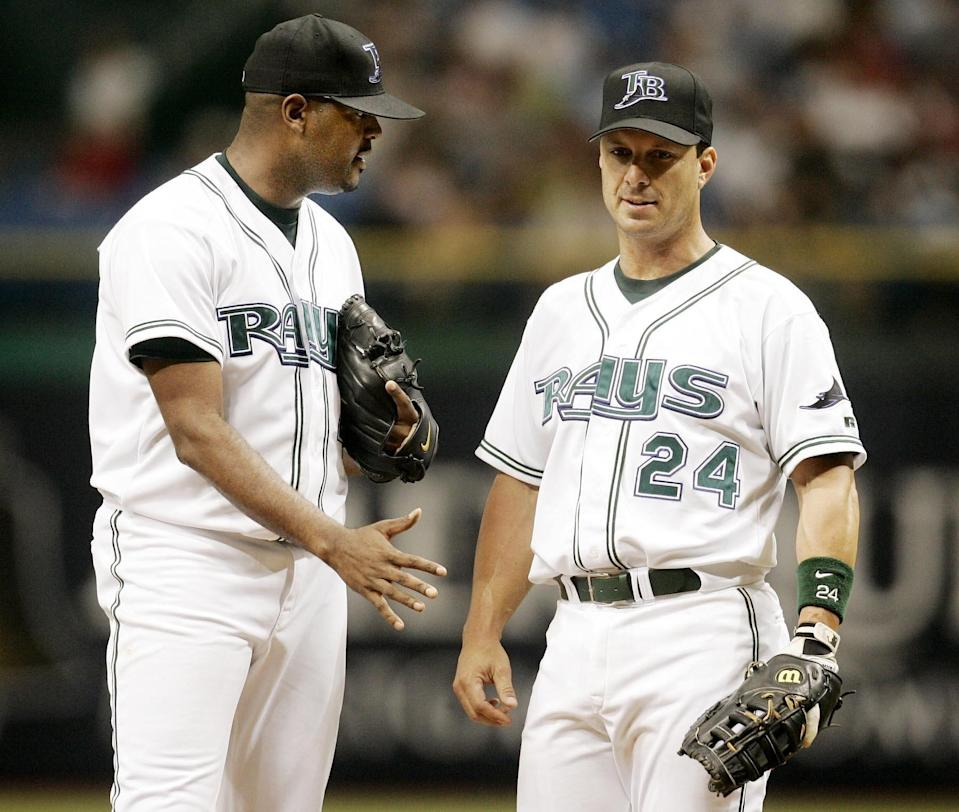 Tampa Bay first baseman Tino Martinez, right, tries to settle down pitcher Dewon Brazelton, left, during the second inning July 17, 2004.