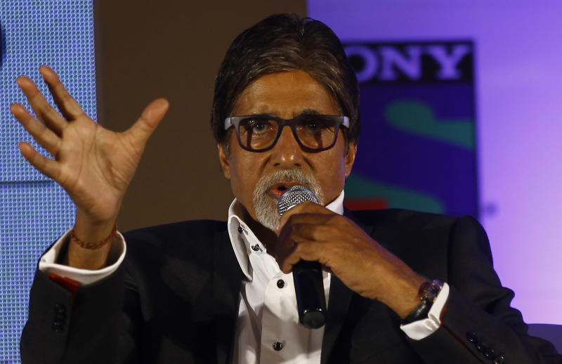 "Bollywood actor Amitabh Bachchan gestures speaks during a press conference in Mumbai, India, Wednesday, June 5, 2013. Bachchan, host of the popular quiz show ""Kaun Banega Crorepati"", India's version of ""Who Wants To Be A Millionaire"", is now said to produce a fiction show for the same channel. (AP Photo/Rafiq Maqbool)"
