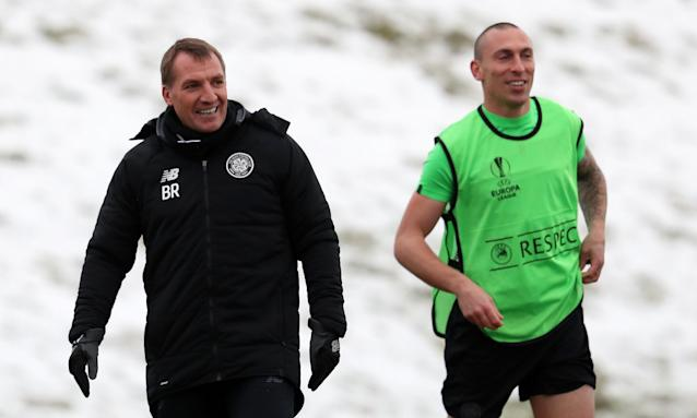 Celtic's Brendan Rodgers and Scott Brown during training for the first leg against Zenit St Petersburg.