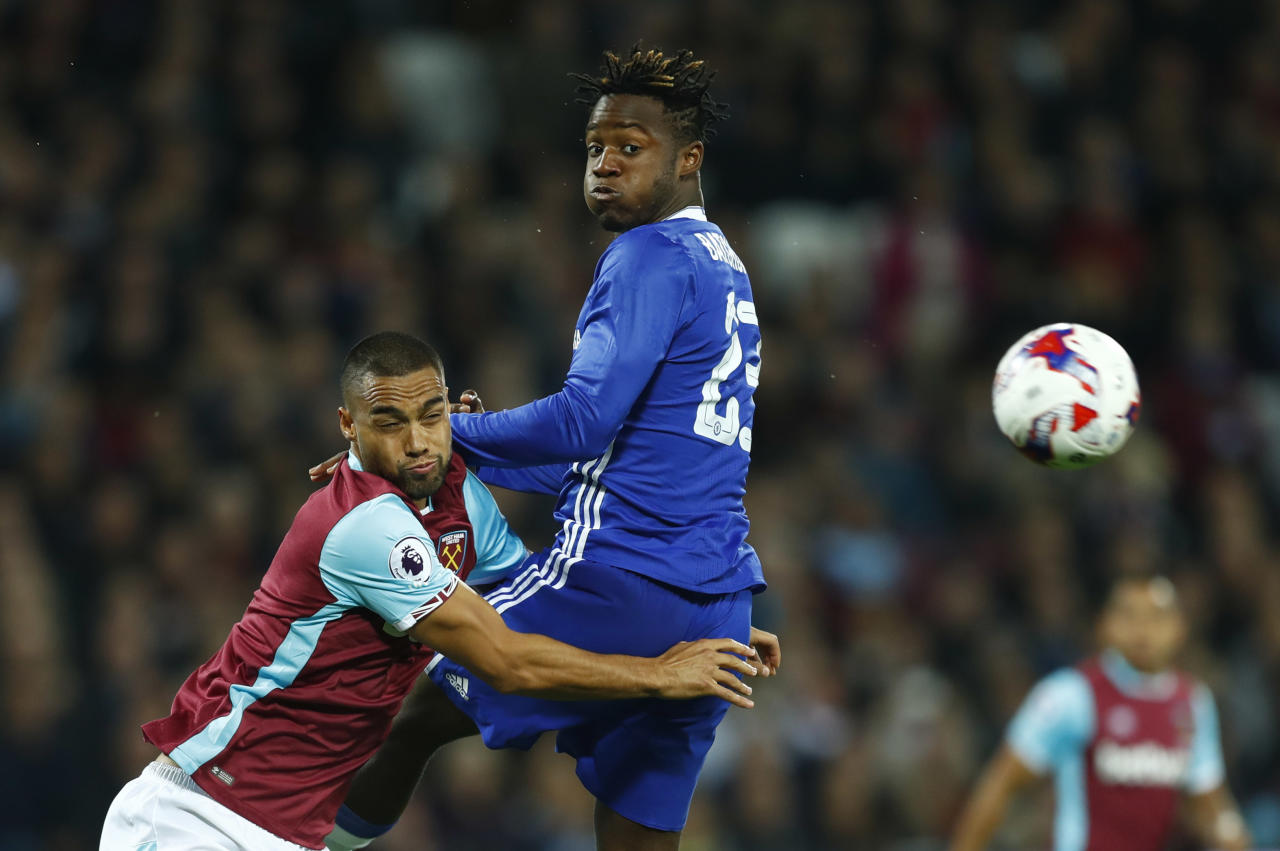"""Football Soccer Britain - West Ham United v Chelsea - EFL Cup Fourth Round - London Stadium - 26/10/16 West Ham United's Winston Reid in action with Chelsea's Michy Batshuayi  Reuters / Eddie Keogh Livepic EDITORIAL USE ONLY. No use with unauthorized audio, video, data, fixture lists, club/league logos or """"live"""" services. Online in-match use limited to 45 images, no video emulation. No use in betting, games or single club/league/player publications. Please contact your account representative for further details."""