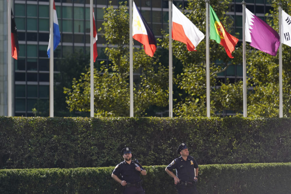 Police officers stand in front of United Nations headquarters in New York, Monday, Sept. 20, 2021. With the coronavirus pandemic still raging in many parts of the world, leaders from more than 100 nations are heading to New York this week for the United Nations' annual high-level gathering — a COVID-inflected, semi-locked down affair that takes place in one of the pandemic's hardest-hit cities of all. (AP Photo/Seth Wenig)