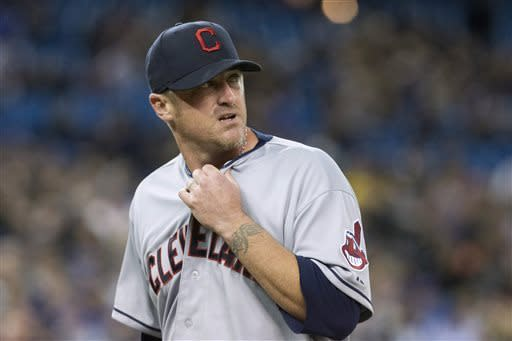 Cleveland Indians starting pitcher Brett Myers walks toward the dugout at the end of the fourth inning of a baseball game against the Toronto Blue Jays in Toronto on Thursday, April 4, 2013. (AP Photo/The Canadian Press, Chris Young)