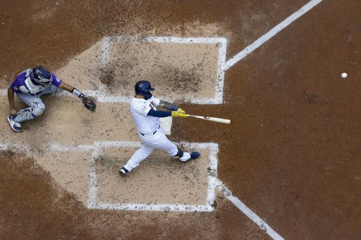 Milwaukee Brewers' Omar Narvaez hits a two-run home run during the sixth inning of a baseball game against the Colorado Rockies Sunday, June 27, 2021, in Milwaukee. (AP Photo/Morry Gash)