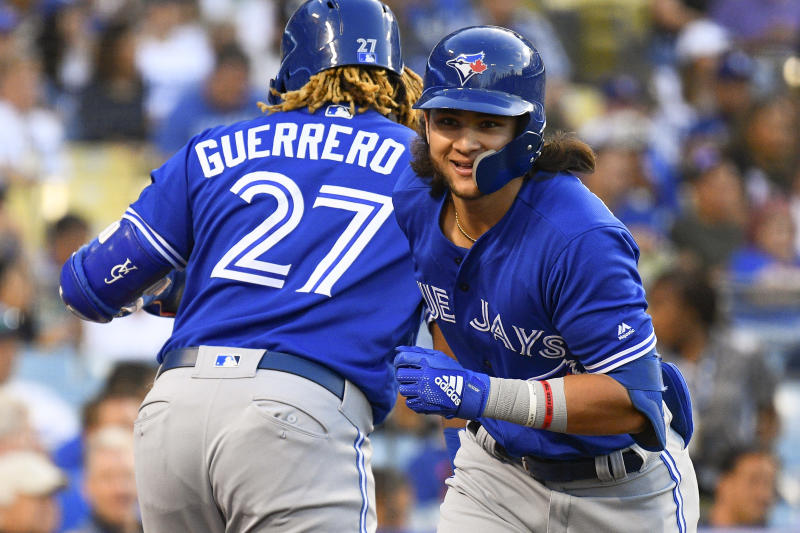 LOS ANGELES, CA - AUGUST 20: Toronto Blue Jays shortstop Bo Bichette (11) celebrates a home run with Toronto Blue Jays third baseman Vladimir Guerrero Jr. (27) during a MLB game between the Toronto Blue Jays and the Los Angeles Dodgers on August 20, 2019 at Dodger Stadium in Los Angeles, CA. (Photo by Brian Rothmuller/Icon Sportswire via Getty Images)