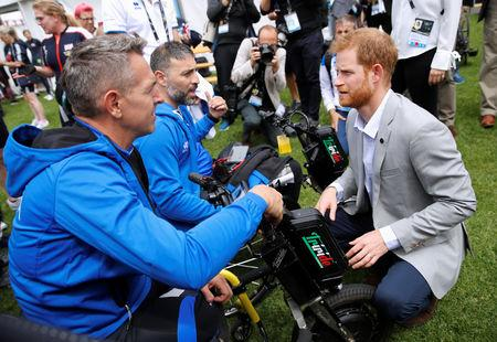 Britain's Prince Harry talks to Italian athletes during the Invictus Games at the Royal Botanic Garden in Sydney, Australia October 21, 2018. REUTERS/Phil Noble