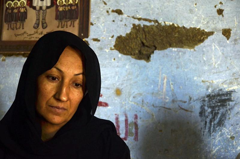 The mother of 24-year-old school teacher Dimyana Abdel-Nour, who is accused of insulting Islam while teaching fourth graders history of religions, talks about her daughter in her home in southern Egypt's ancient city of Luxor, Egypt, Thursday, May 16, 2013. Freed on Tuesday on a 20,000-pound (nearly 3,000 dollars) bail after nearly a week in detention, Abdel-Nour is due to stand trial later this month. Criminalizing blasphemy was enshrined in the country's new Islamist-backed constitution adopted in December. (AP Photo/Ibrahim Zayed)