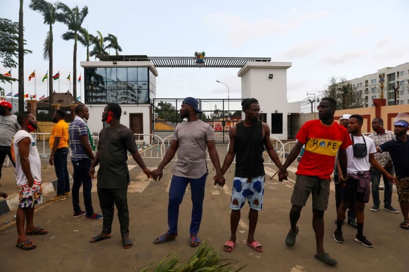 FILE PHOTO: Demonstrators hold hands as they gather near the Lagos State House
