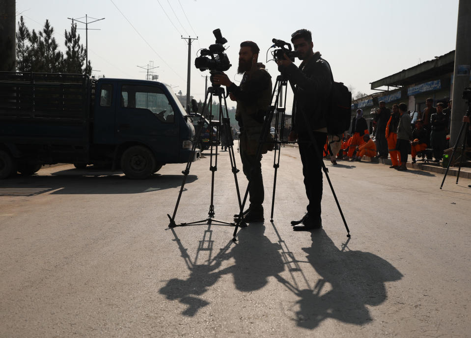 Afghan journalists film at the site of a bombing attack in Kabul, Afghanistan, Tuesday, Feb. 9, 2021. The coordinated killings in Jalalabad on Tuesday, March 2, 2021, of three women working for a local radio and TV station in Jalalabad were the latest in a bloody campaign against journalists in Afghanistan, a country that was already considered one of the most dangerous places in the world to be a journalist. In just the last six months, 15 journalists have been killed in a series of targeted killings. (AP Photo/Rahmat Gul)