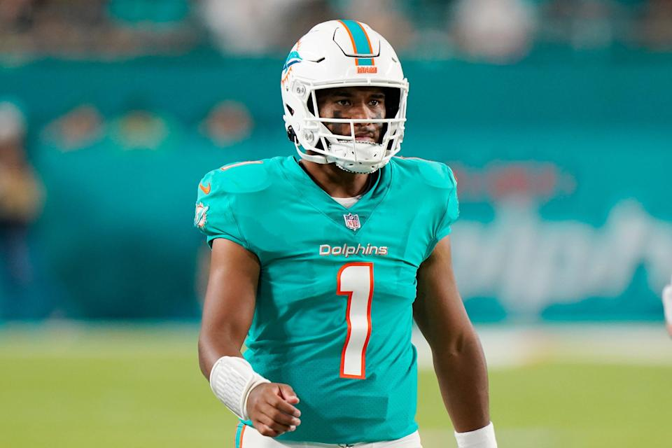 Miami Dolphins quarterback Tua Tagovailoa (1) stands on the field during the first half of a NFL preseason football game against the Atlanta Falcons, Saturday, Aug. 21, 2021, in Miami Gardens.