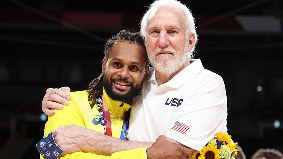 Pictured here, Aussie star Patty Mills and Team USA coach Gregg Popovich embrace at the Olympics.