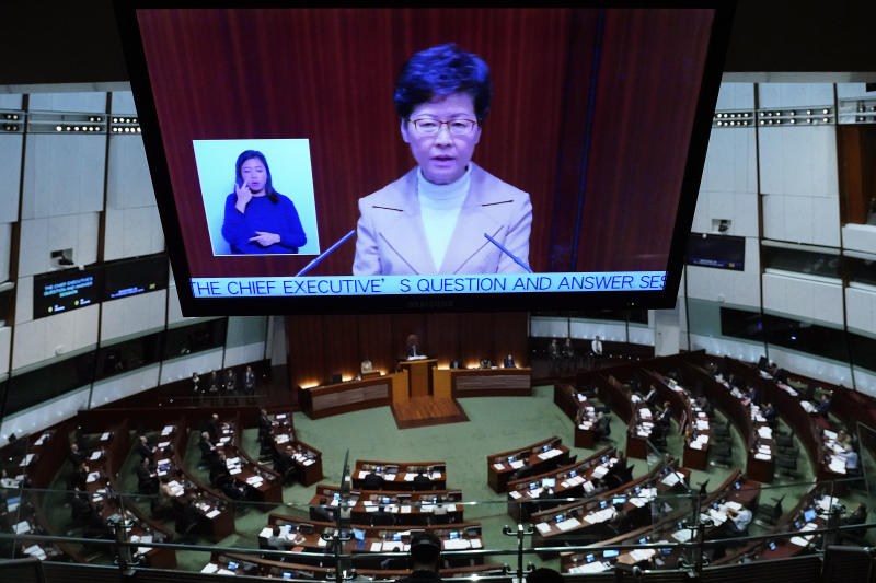 Hong Kong Chief Executive Carrie Lam appears at a TV screen while speaking during a question and answer session at the Legislative Council in Hong Kong Thursday, Jan. 16, 2020. (AP Photo/Vincent Yu)