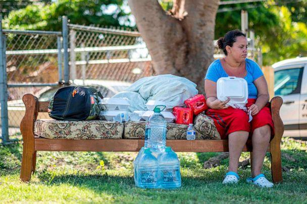 PHOTO: A woman sits on a sofa in a camp set up at a baseball field in Guanica, Puerto Rico on Jan. 11, 2020, after a powerful earthquake hit the island. (AFP via Getty Images)