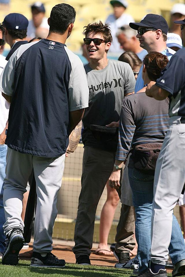 """Turns out there are a lot of Yankees fans in Los Angeles. Zac Efron hit the field pre-game for a meet and greet with New York players including No. 20, Jorge Posada. London Entertainment/<a href=""""http://www.splashnewsonline.com"""" target=""""new"""">Splash News</a> - June 27, 2010"""
