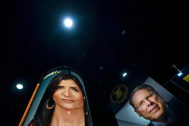 <p>Photographs of National Rifle Association (NRA) spokesperson Dana Loesch (L) and NRA executive vice president and CEO Wayne LaPierre (R) hang in the vendors area of the 45th annual Conservative Political Action Conference (CPAC) at the Gaylord National Resort & Convention Center in National Harbor, Md., Feb. 23 2018. (Photo: Jim Lo Scalzo/EPA-EFE/REX/Shutterstock) </p>