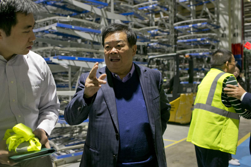 MORAINE, OH - SEPTEMBER, 29: Cho Tak Wong, center, chairman, and his Charles Cheng, left, translating for Mr. Wong, tour the plant at Fuyao Glass in Moraine, Ohio on September 29, 2016. Cho Tak Wong, the chairman of Fuyao Glass, one of the largest auto glass manufacturers in the world, bought the vacant General Motors manufacturing plant in Moraine, Ohio in 2014. The plant was retooled and is now making glass for General Motors. (Andrew Spear for The Washington Post via Getty Images)