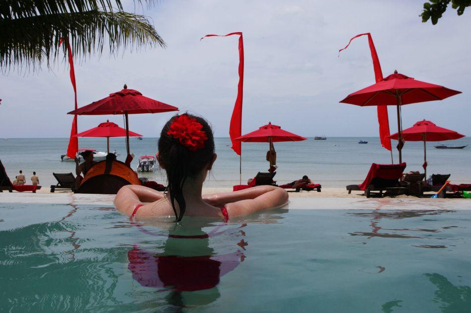 A woman enjoys the beachside pool at the Anantara Rasananda resort on the island of Koh Phangan off the coast of Koh Samui.