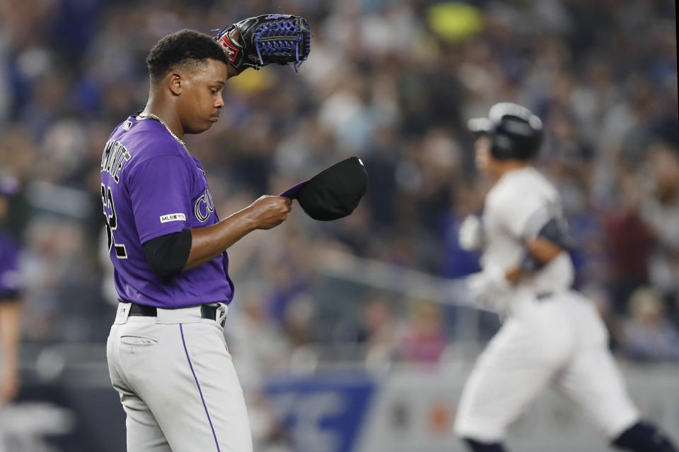 Colorado Rockies relief pitcher Yency Almonte removes his cap as New York Yankees' Aaron Judge runs the bases after hitting a two-run home run during the sixth inning of a baseball game Friday, July 19, 2019, in New York. (AP Photo/Kathy Willens)