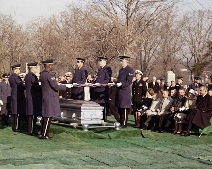 FILE - In this Jan. 31, 1967 file photo, mourners attend the burial of astronaut Virgil Grissom at the Arlington National Cemetery in Arlington, Va. Grissom, 40, was selected in 1959 as one of the seven original Mercury astronauts. Known as the hard luck astronaut, he had to swim for his life when his craft, Liberty Bell 7, sank after its descent on the second U.S. manned space flight July 21, 1961. (AP Photo)