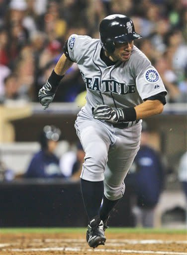 Seattle Mariners' Ichiro Suzuki races up the first-base line on an RBI single against the San Diego Padres during the fourth iinning of a baseball game Saturday, June 23, 2012, in San Diego. (AP Photo/Lenny Ignelzi)