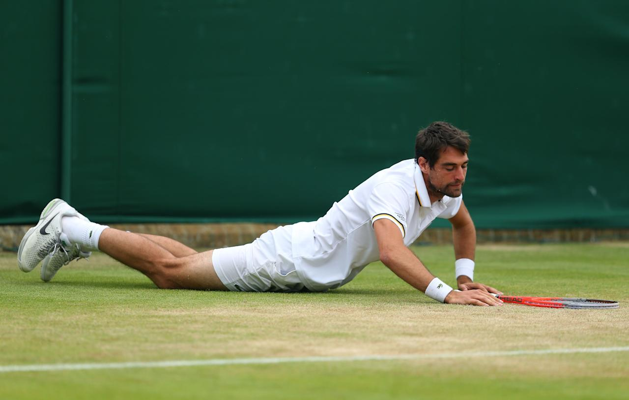 LONDON, ENGLAND - JUNE 27: Jeremy Chardy of France slips on the grass during his Gentlemen's Singles second round match against Jan-Lennard Struff of Germany on day four of the Wimbledon Lawn Tennis Championships at the All England Lawn Tennis and Croquet Club on June 27, 2013 in London, England. (Photo by Julian Finney/Getty Images)