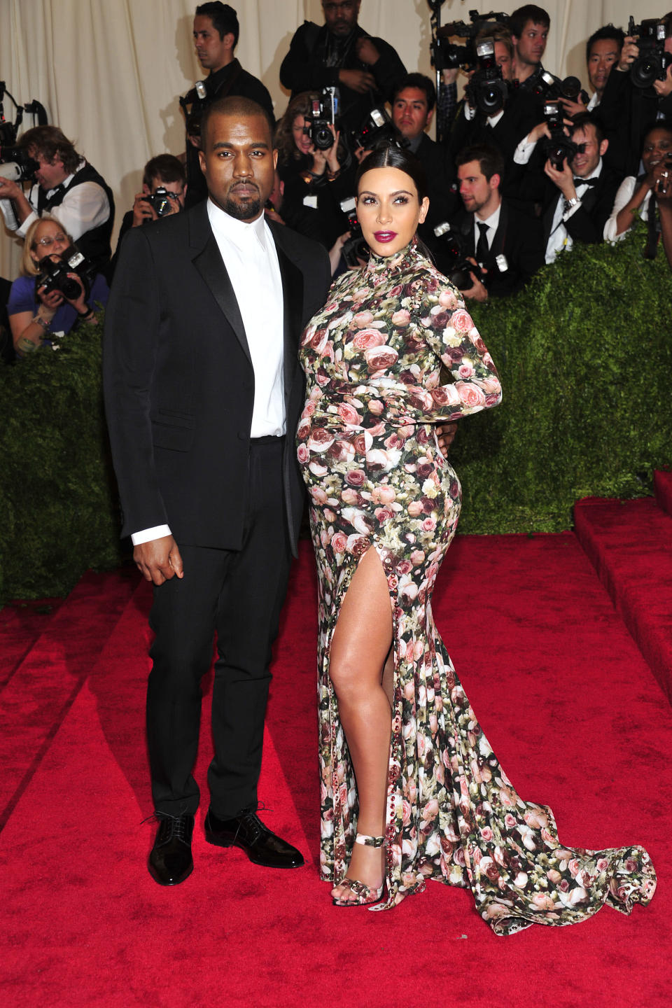 """Kanye West and Kim Kardashian attends The Metropolitan Museum of Art's Costume Institute benefit celebrating """"PUNK: Chaos to Couture"""" on Monday May 6, 2013 in New York. (Photo by Charles Sykes/Invision/AP)"""