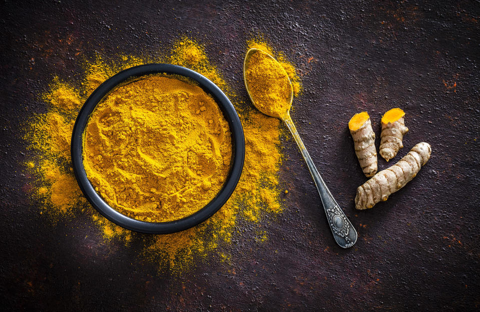 Spices: Turmeric roots and powder shot from above (fcafotodigital / Getty Images)