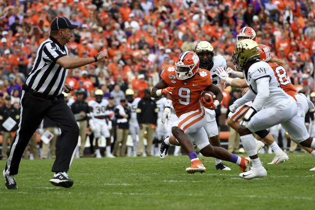 Clemson's Travis Etienne rushes for a touchdown during the first half of an NCAA college football game against Wake Forest, Saturday, Nov. 16, 2019, in Clemson, S.C. (AP Photo/Richard Shiro)
