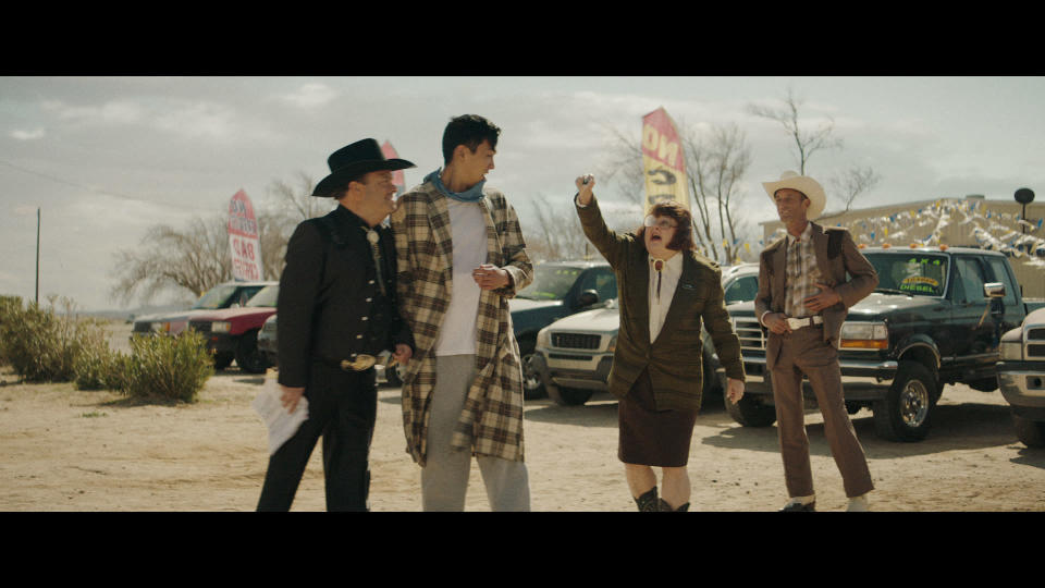 This photo provided by Vroom shows a scene from Vroom Super Bowl NFL football spot. (Vroom via AP)