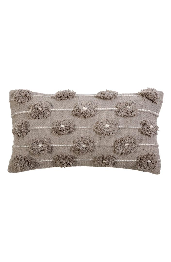"""The more <a href=""""https://www.architecturaldigest.com/story/best-throw-pillows?mbid=synd_yahoo_rss"""" rel=""""nofollow noopener"""" target=""""_blank"""" data-ylk=""""slk:pillows"""" class=""""link rapid-noclick-resp"""">pillows</a> the merrier–and this one has added charm, with tufted gray flowers and white piping. $103, Nordstrom. <a href=""""https://www.nordstrom.com/s/pom-pom-at-home-lola-accent-pillow/5296441"""" rel=""""nofollow noopener"""" target=""""_blank"""" data-ylk=""""slk:Get it now!"""" class=""""link rapid-noclick-resp"""">Get it now!</a>"""