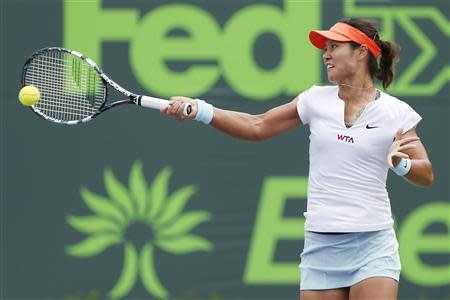 Mar 29, 2014; Miami, FL, USA; Li Na hits a forehand against Serena Williams (not pictured) during the women's final of the Sony Open at Crandon Tennis Center. Mandatory Credit: Geoff Burke-USA TODAY Sports