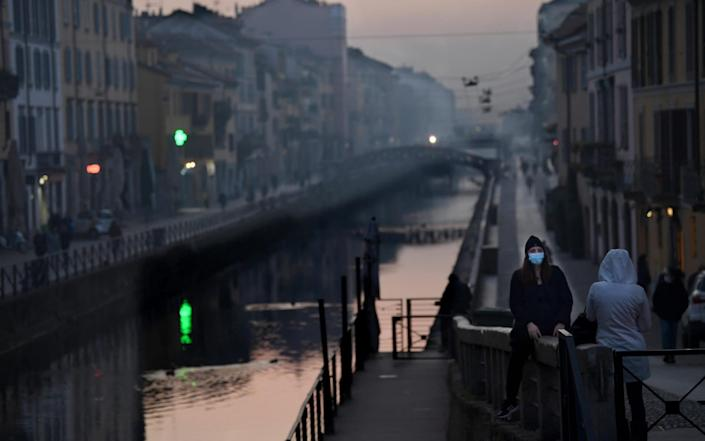 The almost deserted Navigli district of Milan, normally a place of busy bars and restaurants - Shutterstock