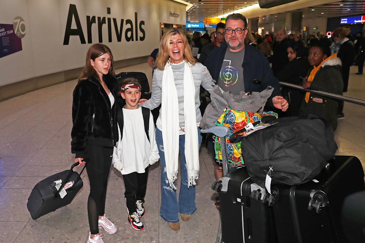 Kate Garraway, alongside her husband Derek Draper and two children Darcey, 13, and Bill, 10, arrives back at Heathrow Airport after the 2019 series of I'm A Celebrity ... Get Me Out Of Here! (Photo by Steve Parsons/PA Images via Getty Images)