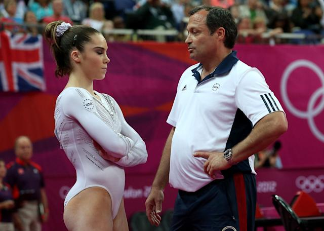 <p>(L-R) McKayla Maroney Maroney of the United States looks on as she is consoled by coach Yin Alvarez after she fell on a dismount while competing in the Artistic Gymnastics Women's Vault Final on Day 9 of the London 2012 Olympic Games at North Greenwich Arena on August 5, 2012 in London, England. (Photo by Ronald Martinez/Getty Images) </p>