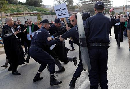 Police attempt to disperse lawyers trying to force their way to the constitutional council during a protest to denounce an offer by President Abdelaziz Bouteflika to run in elections next month but not to serve a full term if re-elected, in Algiers, Algeria March 7, 2019. REUTERS/Zohra Bensemra