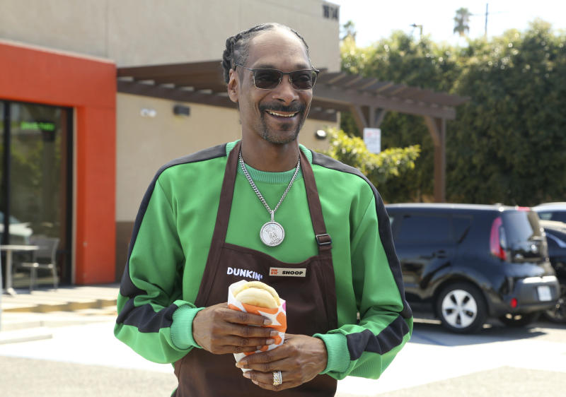 IMAGE DISTRIBUTED FOR BEYOND MEAT - In this image taken on Oct. 23, 2019, Snoop Dogg surprised fans in celebration of the national launch of Dunkin's new Beyond Sausage Sandwich in partnership with Beyond Meat at Dunkin' in Los Angeles. (Photo by Casey Rodgers/Invision for Beyond Meat/AP Images)