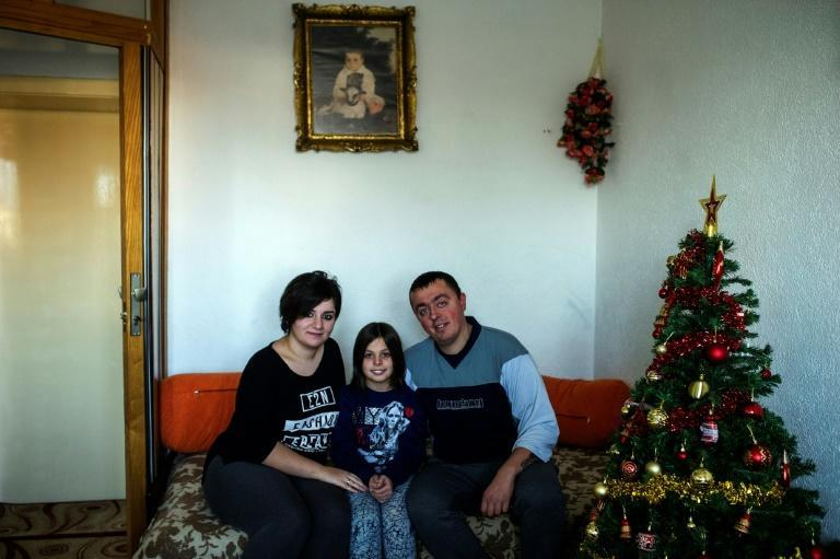 Noora Arkavazi poses with her husband Bobi Dodevski and her step-daughter at their home in Kumanovo, Macedonia