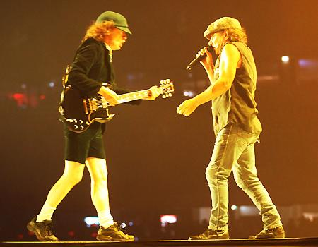 <p>Angus Young and Brian Johnson jiggy it up together on stage for the first of three Melbourne concerts on Thursday 11th February.</p>