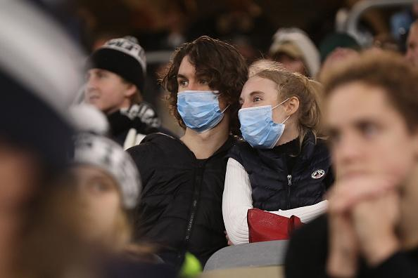 Spectators look on wearing face masks during the round 7 AFL match between the Geelong Cats and the Collingwood Magpies at Optus Stadium.