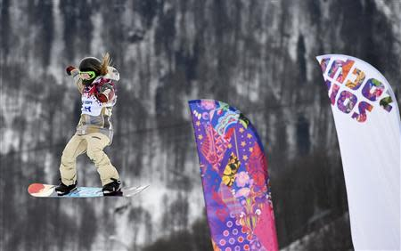 Jamie Anderson of the U.S.performs a jump during the women's snowboard slopestyle finals event at the 2014 Sochi Winter Olympics in Rosa Khutor, February 9, 2014. REUTERS/Dylan Martinez