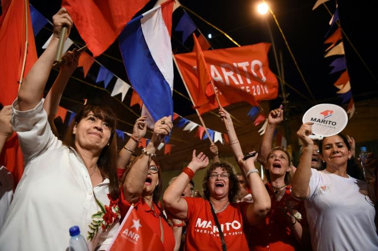 Supporters of Paraguay's Mario Abdo Benitez celebrate his election victory outside the Colorado party headquarters in Asuncion
