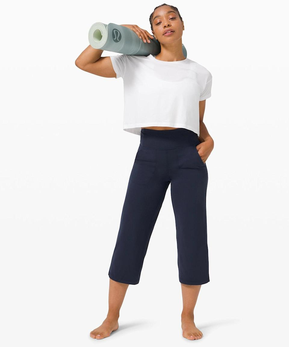 """<h3>Align Wide Leg Crop 23""""</h3><br>The entire Align collection has something for everyone: Leggings at various lengths (something that a 5'2 gal like me sincerely appreciates), insanely soft tops, and palazzo-pant-inspired crops that you can still do downward-facing dog in.<br><br><strong>What They're Saying:</strong> """"Almost all I wear are Align leggings and these are a great addition for a little more variety. These are slightly cropped, but still so cute with a t-shirt and some tennis shoes for errands or hanging around the house.""""<br><br><strong>lululemon</strong> Align™ Wide Leg Crop 23"""", $, available at <a href=""""https://go.skimresources.com/?id=30283X879131&url=https%3A%2F%2Fshop.lululemon.com%2Fp%2Fwomen-crops%2FAlign-Wide-Leg-Crop%2F_%2Fprod9820405%3Fcolor%3D31382"""" rel=""""nofollow noopener"""" target=""""_blank"""" data-ylk=""""slk:lululemon"""" class=""""link rapid-noclick-resp"""">lululemon</a>"""
