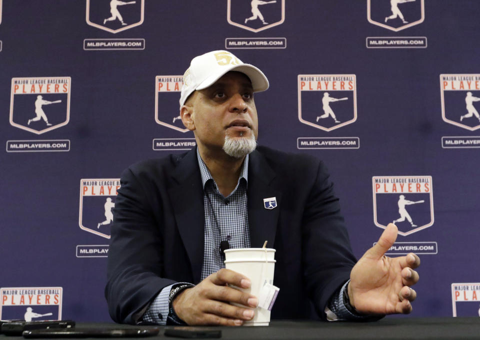 FILE - In this Feb. 19, 2017, file photo, Major League Players Association Executive Director Tony Clark, answers questions at a news conference in Phoenix. Commissioner Rob Manfred says there might be no major league season after a breakdown in talks between teams and the union on how to split up money in a season delayed by the coronavirus pandemic. The league also said several players have tested positive for COVID-19. Two days after union head Clark declared additional negotiations futile, Deputy Commissioner Dan Halem sent a seven-page letter to players' association chief negotiator Bruce Meyer asking the union whether it will waive the threat of legal action and tell MLB to announce a spring training report date and a regular season schedule. (AP Photo/Morry Gash, File)