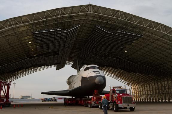The space shuttle Enterprise, mounted on transport vehicle, is seen under a hanger at John F. Kennedy (JFK) International Airport in New York.