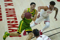 Oregon guard Chris Duarte drives to the basket as Utah forward Timmy Allen (1) defends during the first half of an NCAA college basketball game Saturday, Jan. 9, 2021, in Salt Lake City. (AP Photo/Rick Bowmer)