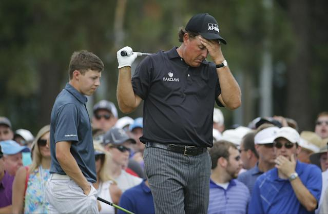 Phil Mickelson, right, reacts to his tee shot on the eighth hole as Amateur, Matthew Fitzpatrick, England, elks by during the first round of the U.S. Open golf tournament in Pinehurst, N.C., Thursday, June 12, 2014. (AP Photo/Matt York)