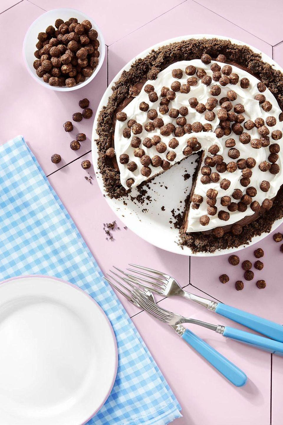 """<p>There are sliced bananas hiding under the chocolatey filling.</p><p><em><a href=""""https://www.countryliving.com/food-drinks/recipes/a46350/cocoa-puffs-and-banana-pie-recipe/"""" rel=""""nofollow noopener"""" target=""""_blank"""" data-ylk=""""slk:Get the recipe from Country Living »"""" class=""""link rapid-noclick-resp"""">Get the recipe from Country Living »</a></em></p>"""