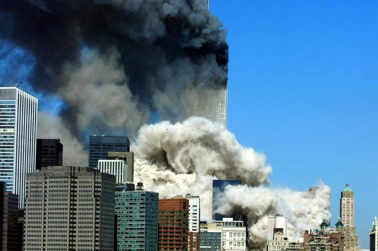 Black smoke billows from the World Trace Center after the first tower collapsed on September 11, 2001