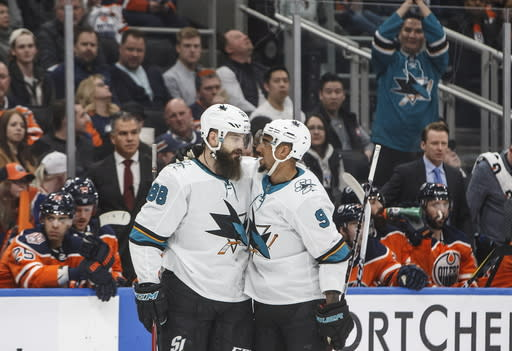San Jose Sharks' Brent Burns (88) and Evander Kane (9) celebrate a goal against the Edmonton Oilers during the first period of an NHL hockey game Thursday, April 4, 2019, in Edmonton, Alberta. (Jason Franson/The Canadian Press via AP)